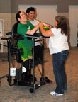 Marklund client using therapeutic stander purchased with grant from the Community Foundation of the Fox River Valley.