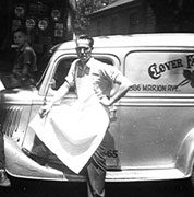 Claude Allen standing by his delivery truck